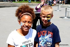 Children having fun with free face painting at GRandJazzFest