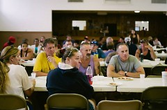 Attendees of Love Feast sit together at a table.