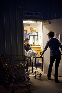 A woman leaves a Kent County food pantry with groceries, one of the 354,000 food-insecure people in West Michigan and the U.P.