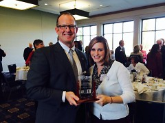 BGC-DR Executive Director Rick Huisman and Director of Development Nicole Rodammer with Education Award.