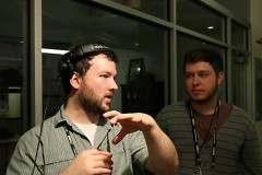 GRTV Station Manager Ted Diedrich and former intern Ryan Hagerman collect video responses from attendees