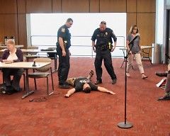 ATU Activist Louis DeShane Lays on the floor with his arms spread just before being arrested at the Rapid board meeting
