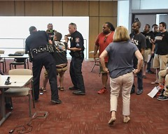 Louis DeShane is being arrested at the August 30,  2017 Rapid Board meeting