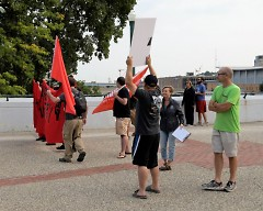 Protesters block Grand Rapids Mayor Rosalynn Bliss from addressing walker at the start of the local Labor Day Bridge Walk