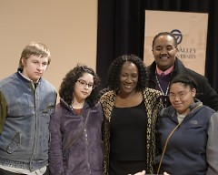 Christy S. Coleman poses for a photo with John Crowley and residents of the Gerald Ford Job Corps