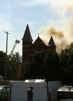 Smoke pouring out of the church building