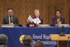 Grand Rapids Mayor Rosalynn Bliss looking over the meeting agenda