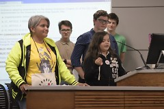 Gema Lowe supporting a young speaker at Tuesday's City Commission meeting.