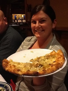 EatGr member Shawna Swan passes the patate