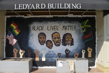 Mural along downtown Grand Rapids' Monroe Center St. of the faces of lives lost to racially-based police brutality.