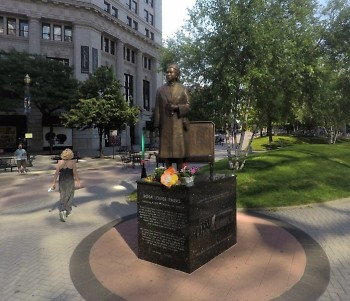 Rosa Parks statue, next to Monroe Center St. NW and the new Breonna Taylor Way.