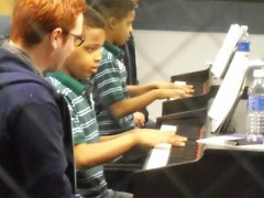 BGCGRYC Music Program Coordinator Casey Stratton teaching piano lessons.