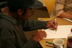 Member Damon Crawford works on a piece during the biweekly meetup.