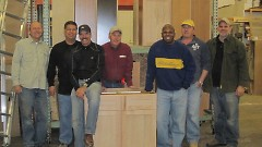 Woodshop volunteers turn out pieces of cabinetry that can be painted to match furniture for purchase at Builder's Abundance.