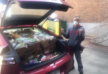 Dave Cobb, manager at one of Grand Rapids' Aldi stores, donating food to the Grand Rapids Service Industry Network (GRSIN).
