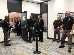Kent County Sheriff officers at the door of the Kent County Commission meeting