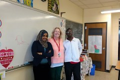 Amina Abdullahi and Abdelsalam Yaya with their teacher Erika Curtiss, who works with refugee and immigrant students.