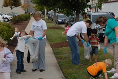 Huntington Bank volunteers work with children from the David D. Hunting YMCA childcare to pick up litter. Day of Caring 2008.