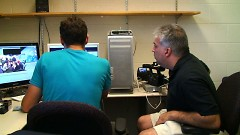 Salvatore Alaimo and videographer Aaron Bannasch looking at footage