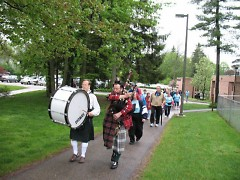 Bagpipers lead the 2k Big Step Walk through Aquinas College Campus.