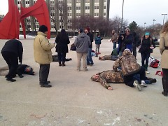 The rally at Calder Plaza included drawing chalk outline bodies around the plaza