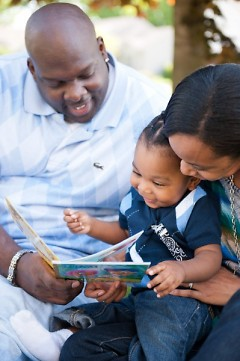 Kevin and Trinity Clemens read to their son, Zion.