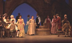 Kristen Burghart (center, by the well) plays the part of a Madrigal Singer.