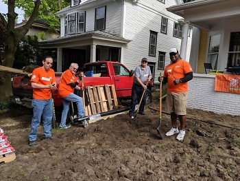 Home Depot volunteers work at the home of veteran Joe Clemens.