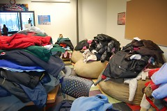 Coats from Taco Bell coat drive sorted out at the Steil Club.