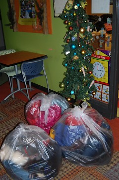 Numerous garbage bags full of winter coats filled Boys & Girls Clubs this week.
