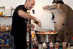 Andreas Papangelopoulos prepares two savory crepes