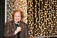 Dégagé's Executive Director Marge Palmerlee talks during last year's Open Hearts Open Doors event.
