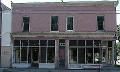 Neglected building prior to re-investment, now home to Rowster's Coffee, a neighborhood grown business.