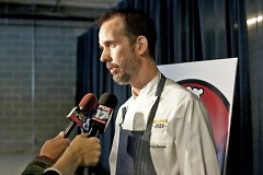 Brian Perrone, executive chef and co-founder answers question from the media