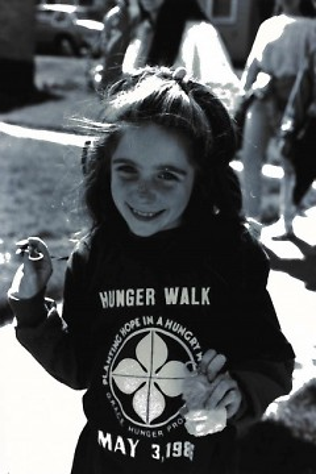 A child dons a G.R.A.C.E. Hunger Walk shirt at the 1986 fundraiser.