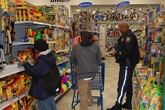 Officer Mike Harris helping Club Members find some great toys for their family members.