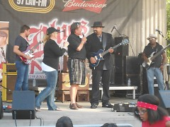 WLAV's Tony Gates is introducing Wayne Baker Brooks and his band for last summer concert for Blues on the Mall 2013.