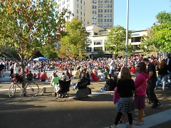 A large crowd of concert goers enjoying the last concert of the summer at Rosa Park Circle in Grand Rapids, Michigan