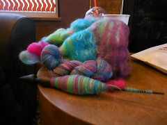 One knitters spinning project sits on a table.