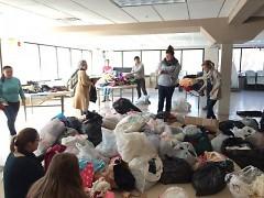 Volunteers sorting donations for refugees at Masjid AT-Tawheed