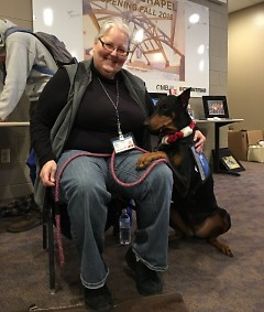 Dutmers and her Doberman Pinscher Meia work together as a team to bring joy to West Michigan.