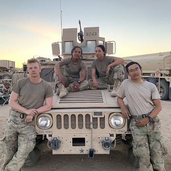 Gabrielle Harrison with fellow soldiers.