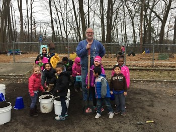 Preschoolers pose with Jeff Smith from Gardens for Grand Rapids who helped them build their garden