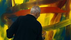 Gerard Richter paints on a canvas