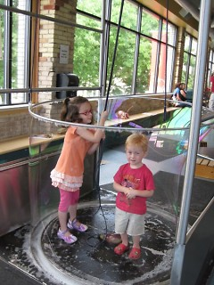 Children enjoying the bubble station at the Grand Rapids Children's Museum