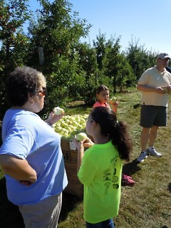 Volunteers enjoy the fruits of their labor at Riveridge.