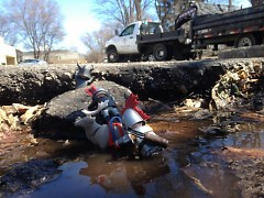 "Gretchen Vinnedge used figurines to create an ""escape"" scene in a pothole near her office."
