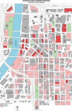 Downtown Grand Rapids. Solid red indicates parking structures. Hatched red/pink indicates surface parking lots.