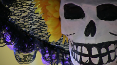 La Calavera Catrina, or Elegant Skull, decorating a community member's altar at Día de los Muertos 2016.