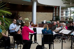 Grand Rapids Symphony's Music for Health musicians play for an open house at Spectrum Health's Lemmen-Holton Cancer Pavilion.